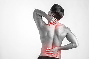 Close up of man rubbing his painful back isolated on white backg